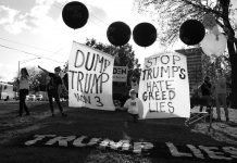 Nashville, Tenn., Oct. 22 - A group of anti-Trump protesters sets up shop on a prominent corner, complete with balloons. (Photo: Ray Di Pietro)