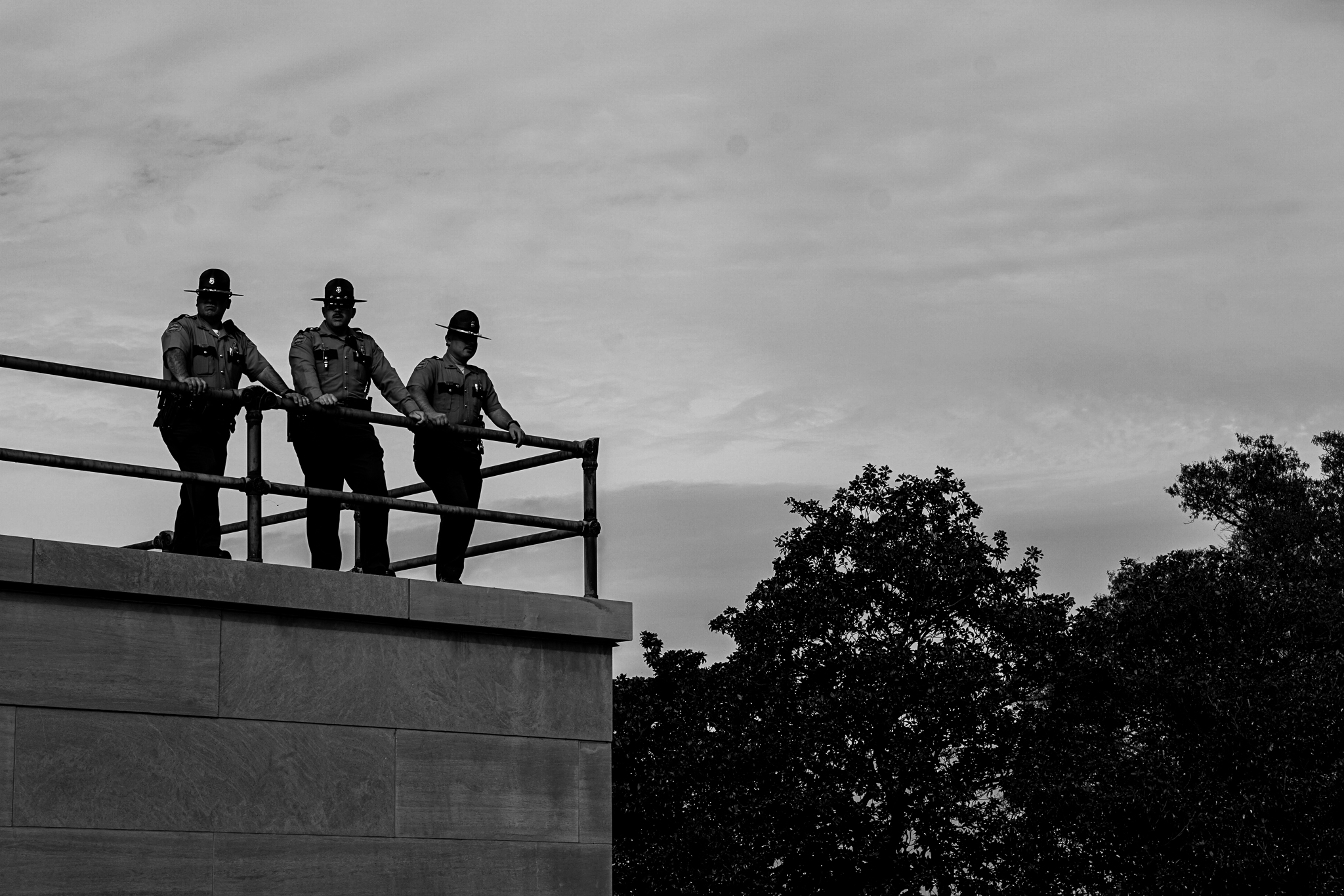 Three Tennessee State Troopers at the capitol look over the crowd below. (Photo: Matt Bastin)