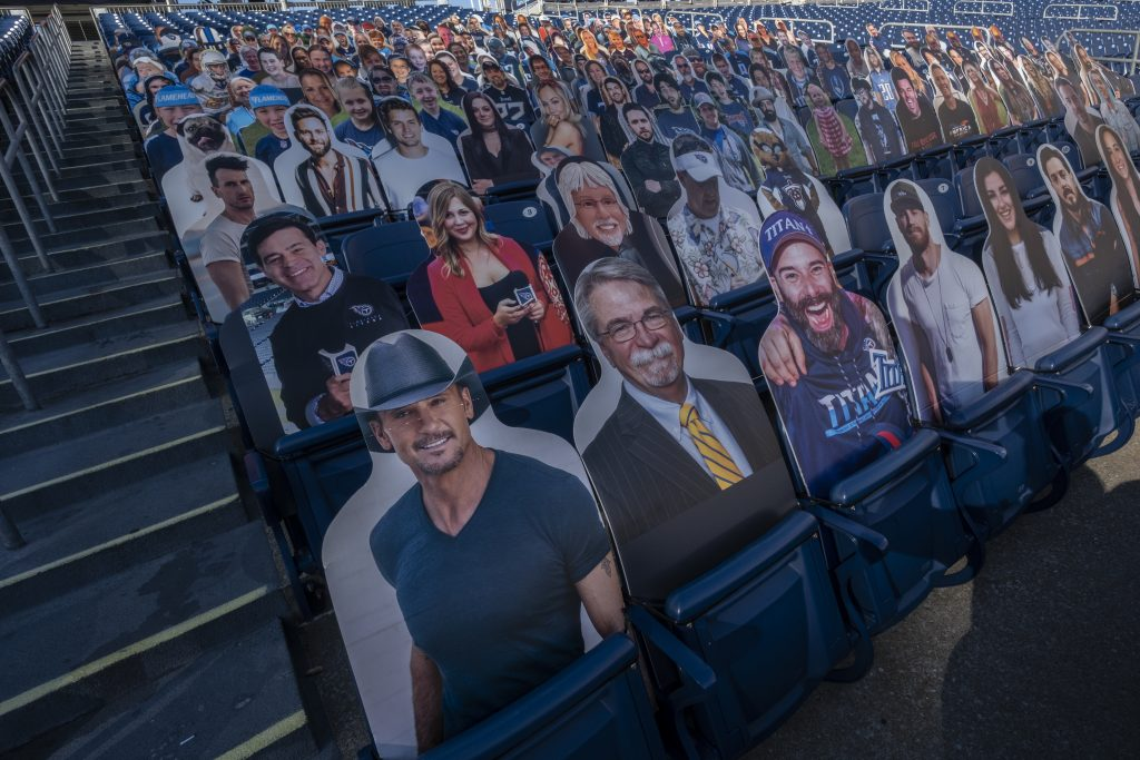 Cardboard cutouts of fans and celebrities, including singer Tim McGraw, are placed in seats at mostly empty Nissan Stadium. Titans officials have limited spectators at home games to a small number of ticket owners. (Photo: John Partipilo)