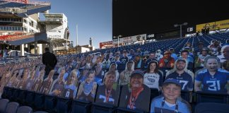 Cardboard cutouts of fans and celebrities are placed in seats at mostly empty Nissan Stadium. (Photo by John Partipilo.)