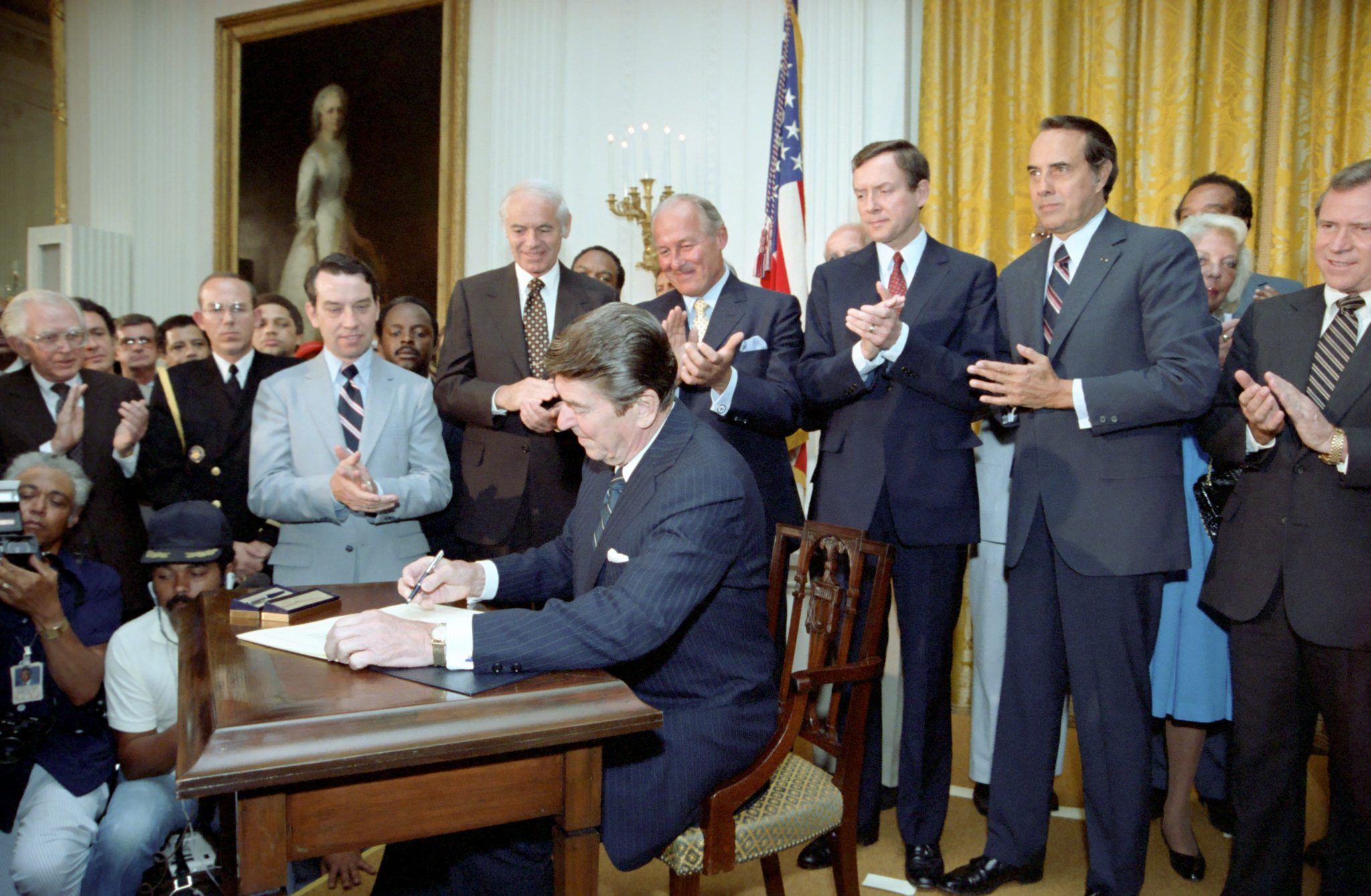 President Ronald Reagan signing Voting Rights Act legislation in the East Room of the White House on June 29, 1982. National Archives from Collection: Reagan White House Photographs