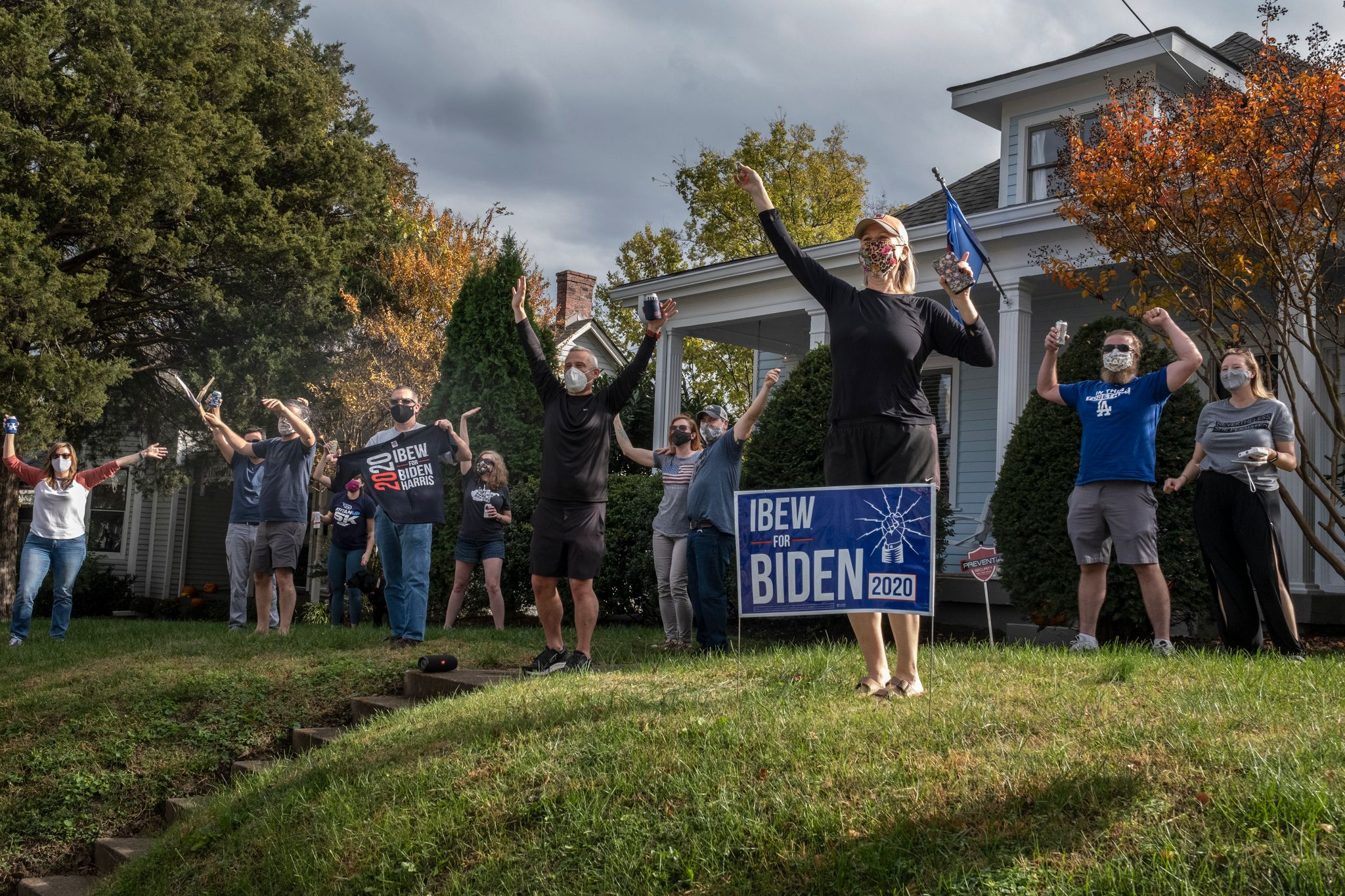 Bobby Hopkins celebrates in her yard with neighbors on Shelby Street in East Nashville (Photo: John Partipilo)
