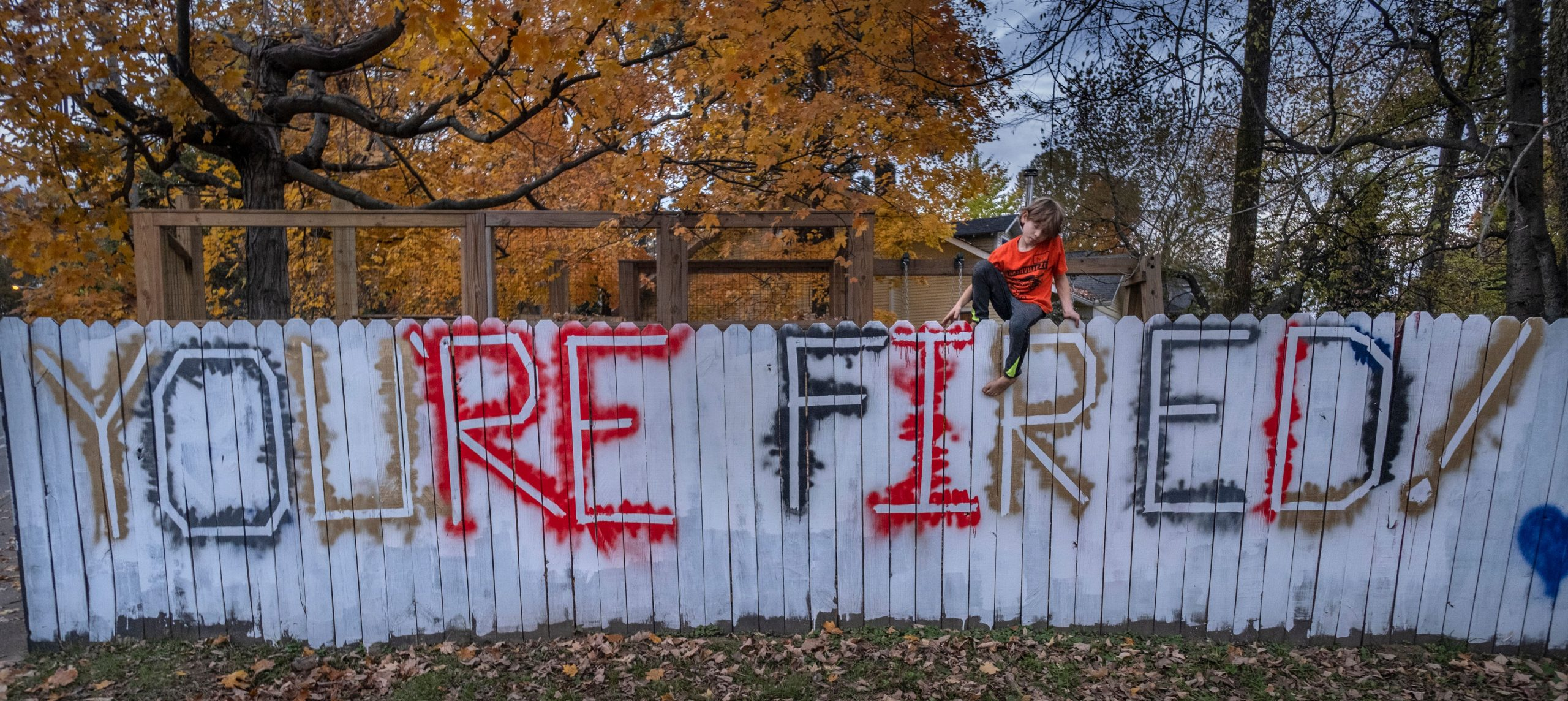 Arlo Suiker,8, sits on the fence at his home in East Nashville that he, mother Andrea Jacobs, father Colin and sister Ruby painted Saturday after Joe Biden became President-elect. (Photo: John Partipilo)