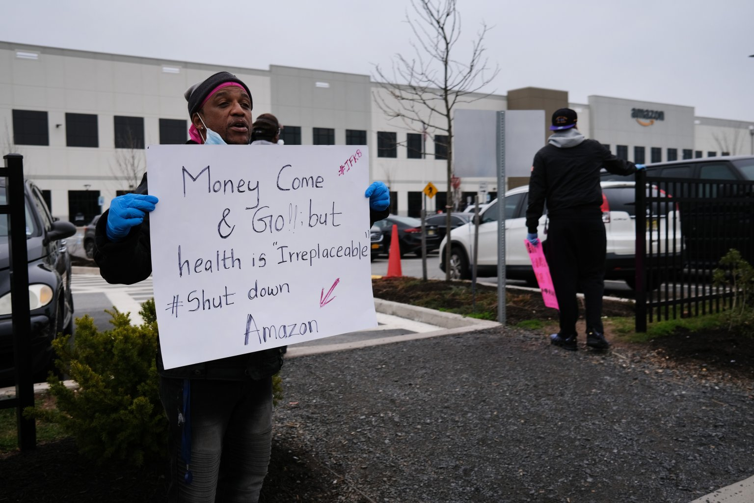 Amazon employees hold a protest and walkout over conditions at the company's Staten Island distribution facility on March 30, 2020 in New York City. Workers at many facilities across the country have protested conditions, as employees have tested positive for the coronavirus. | Spencer Platt/Getty Images.