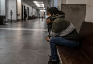 A renter waits outside Davidson County General Sessions Court in November, waiting to see if she can work out a deal with her landlord to stay in her apartment.(Photo: John Partipilo)