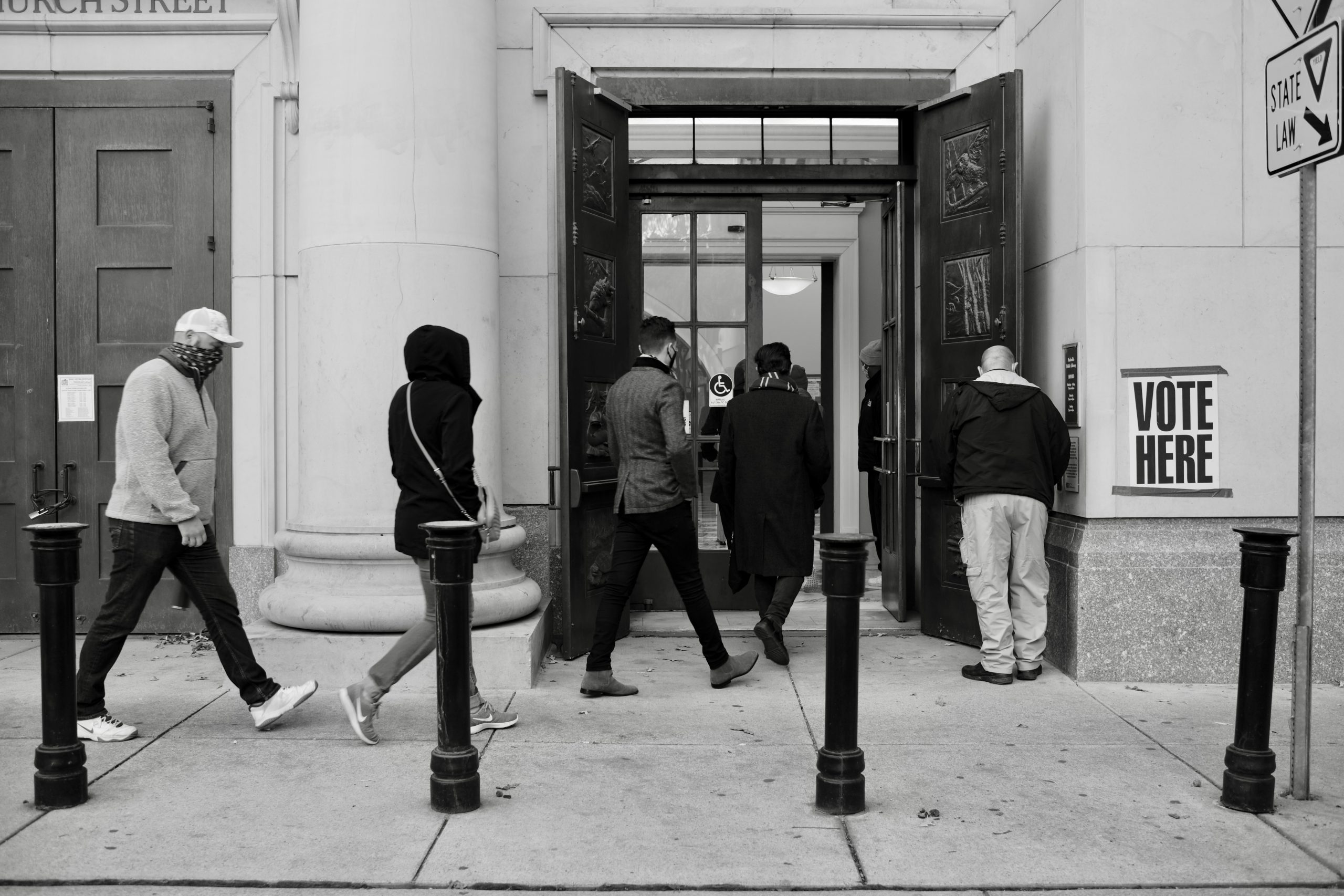 A security guard opens the doors to the Dallas Seymour, 25, waits on line for the polls to open to cast her vote at the Downtown Nashville Public Library polling location. November 3, 2020. 6:47am. (Photo: Ray Di Pietro)