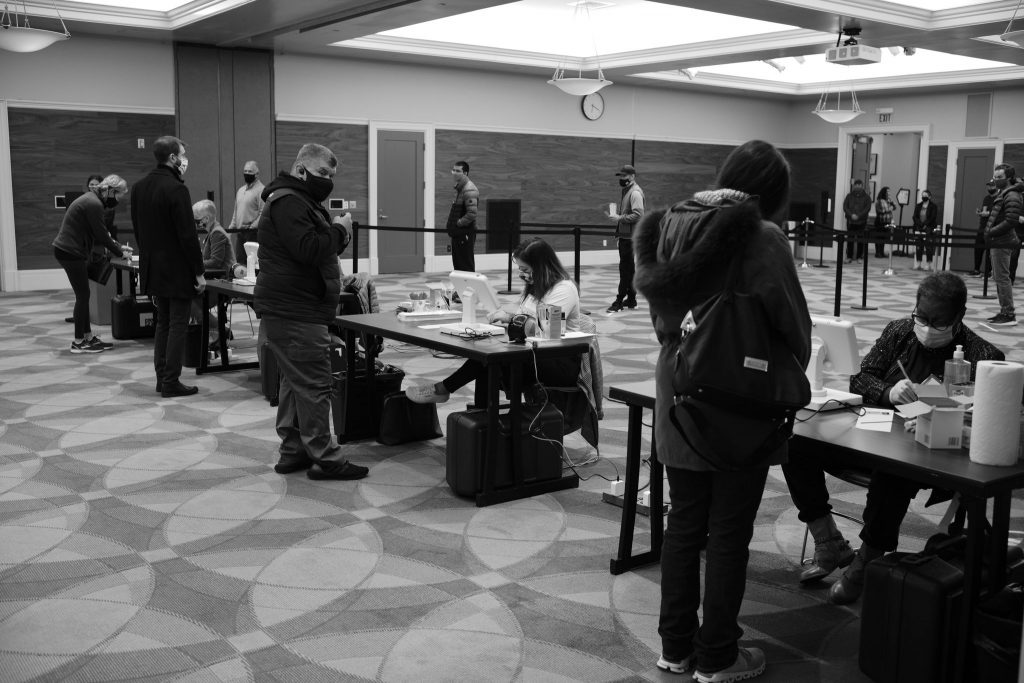 Socially distanced poll workers check in voters at the Downtown Nashville Public Library. (Photo: Ray Di Pietro)