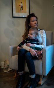 Allie Schmidt holds her young son Asher Friedman 11 months. It is getting harder for her to hold him but she gets help with her husbands parents who help take care of him. (Photo: John Partipilo)
