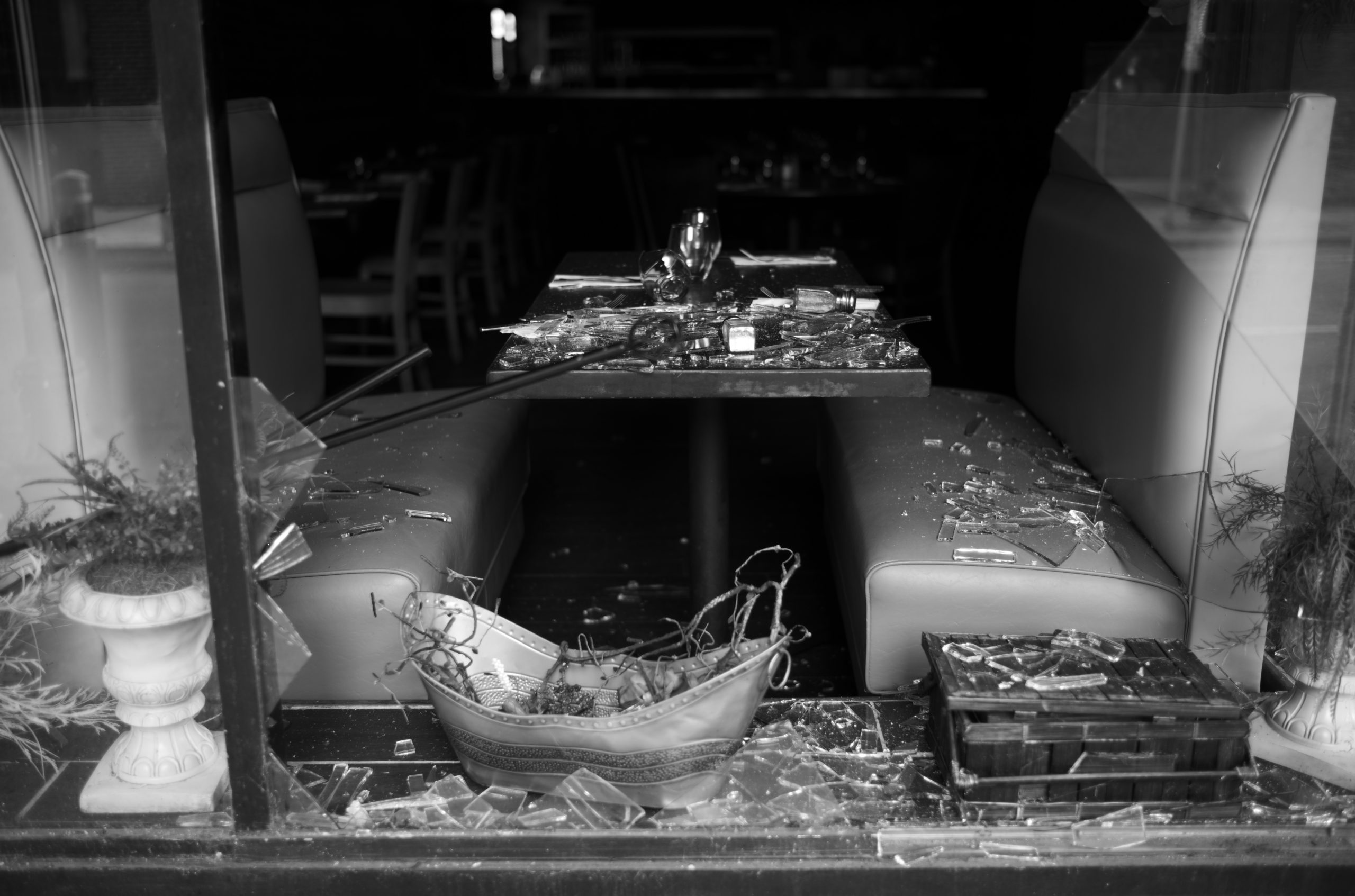 NASHVILLE, Tenn., Dec. 27 - A blown out window and table setting at the Italian Kitchen on 4th Ave, two blocks away from the bombing as ATF agents perform swept the bomb site again. (Photo: Ray Di Pietro)