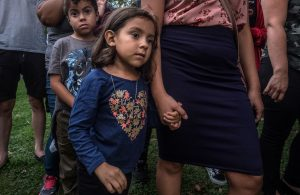 Maria Lopez holds her mothers hand at Bicentennial Park where a 2017 DACA march began.(Photo: John Partipilo)