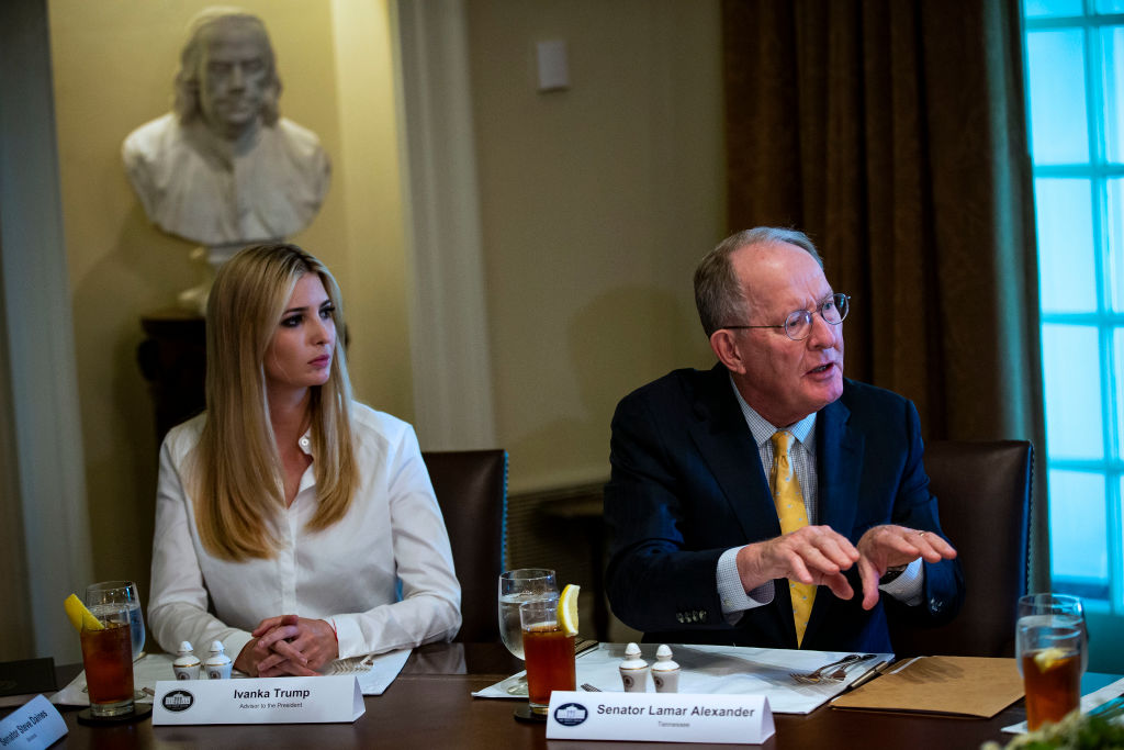 """WASHINGTON, DC - JUNE 26: Ivanka Trump, daughter and assistant to U.S. President Donald Trump, and Sen. Lamar Alexander (R-TN) attend a lunch meeting with Republican lawmakers in the Cabinet Room at the White House June 26, 2018 in Washington, DC. The president called the Supreme Court's 5-4 ruling in favor of the administration's travel ban a """"tremendous victory,"""" according to published reports. (Photo by Al Drago-Pool/Getty Images)"""