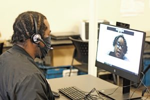 "Job-seeker Sylvester Odom speaks virtually with Goodwill Career Coach Rosie Thompson. She ushered Mr. Odom into a virtual ""room"" where he then spoke directly with the employer. (Photo: Goodwill Industries of Middle Tennessee)"