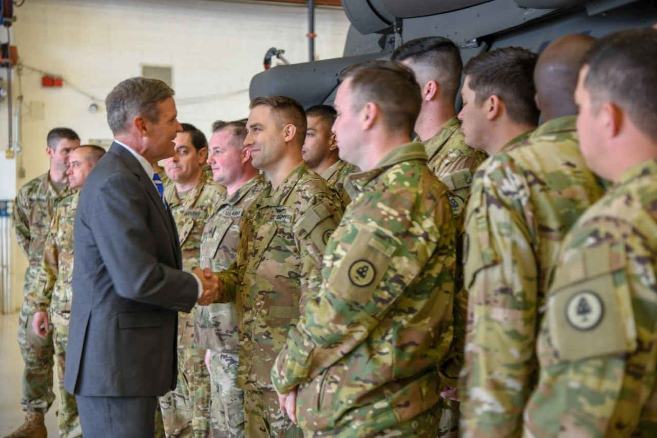Tennessee Governor Bill Lee shakes hands with a member of the Tenn. Army National Guard's 2-135th Aviation Regiment headquartered in Louisville during a visit, Friday, January 3, ahead of the unit's deployment to Kosovo. (Photo by Tenn. Air Guard Master Sgt. Kendra Owenby)