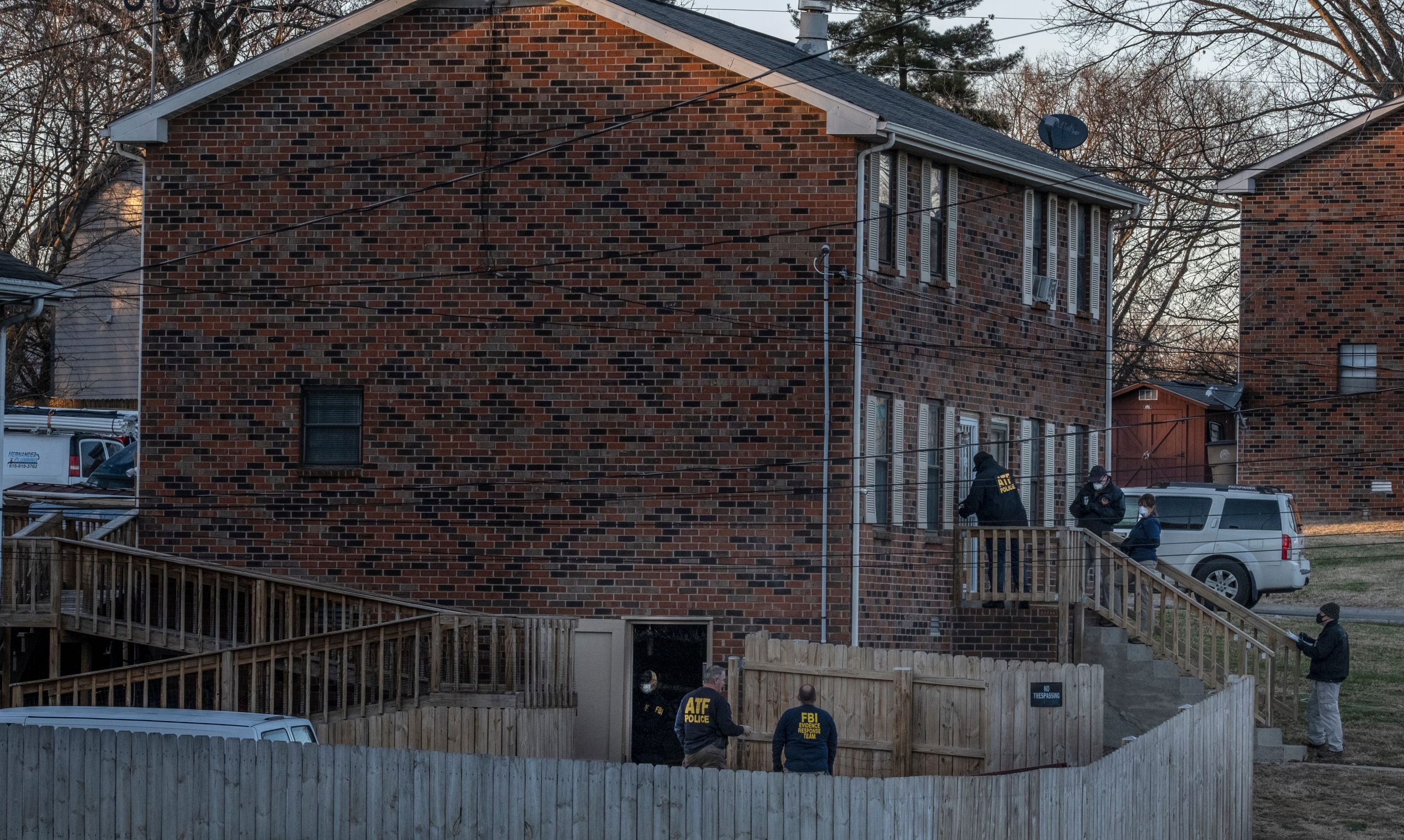 Federal agents enter a house on Bakertown Road in Antioch. (Photo: John Partipilo)