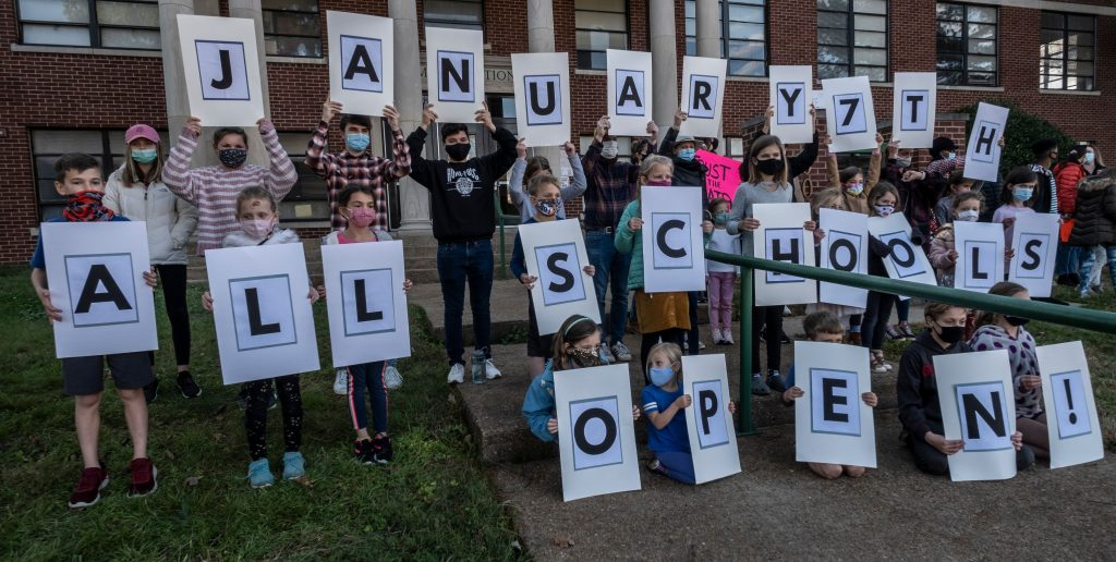 Children participating in a Sunday rally at the office of the Metro Nashville Schools Board hold up placards spelling out 'January All Schools Open.' The rally was organized by Let Nashville Parents Choose, a group advocating to return all schools to in-person learning. (Photo: John Partipilo)