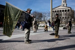 "Armed militia: The Three Percenters, a militia group, ""guard"" the Trump ""Stop the Steal"" protest rally in Legislative Plaza at the Tennessee State Capitol. Downtown Nashville. January 7, 2020. 12:21pm."