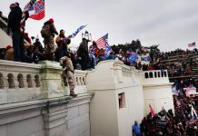 "Thousands of President Donald Trump's supporters storm the U.S. Capitol building following a ""Stop the Steal"" rally on Jan. 6, 2021 in Washington, D.C. The protesters stormed the historic building, breaking windows and clashing with police. Trump supporters had gathered in the nation's capital to protest the ratification of President-elect Joe Biden's Electoral College victory over Trump in the 2020 election. (Photo by Spencer Platt/Getty Images)"