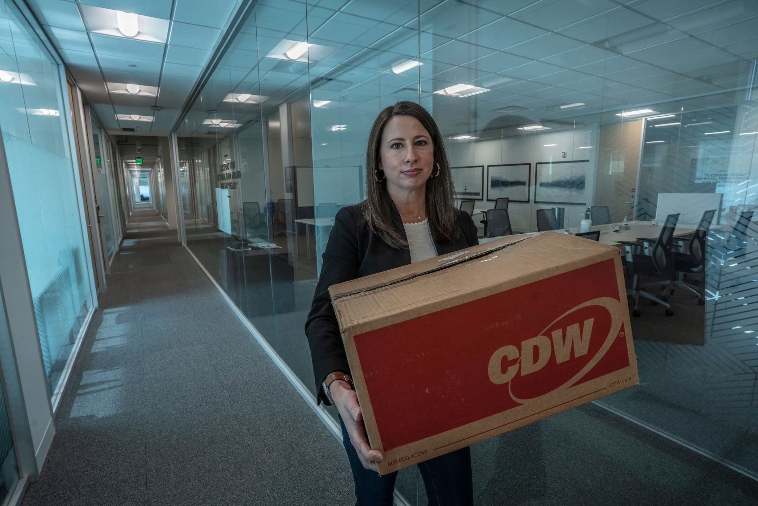 Meg Chamblee of UDig leaves her office with materials to take to her home office. (Photo: John Partipilo)