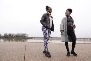 Doula Miajenell Peake (left) walks with her client Jasmine Worles at Shelby Farms Park in Memphis, Tennessee on January 24, 2021. As a doula, Miajenell will support Jasmine with many aspects of her pregnancy and after delivery. ( © Karen Pulfer Focht)