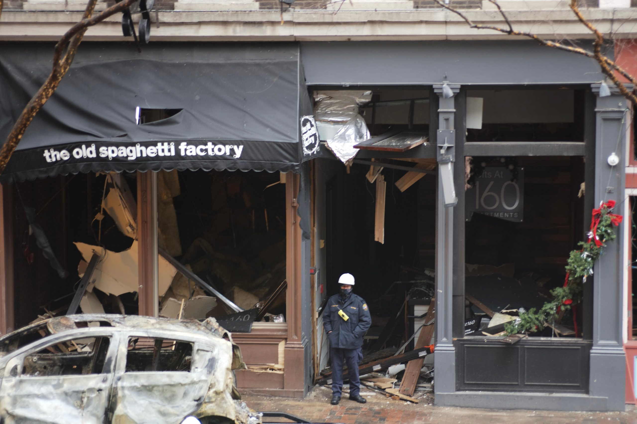 A police officer stands outside the Old Spaghetti Factory on Nashville's Second Avenue on Dec. 31. The restaurant, which opened in 1980, was near the epicenter of the bomb blast. (Photo: Ray Di Pietro)