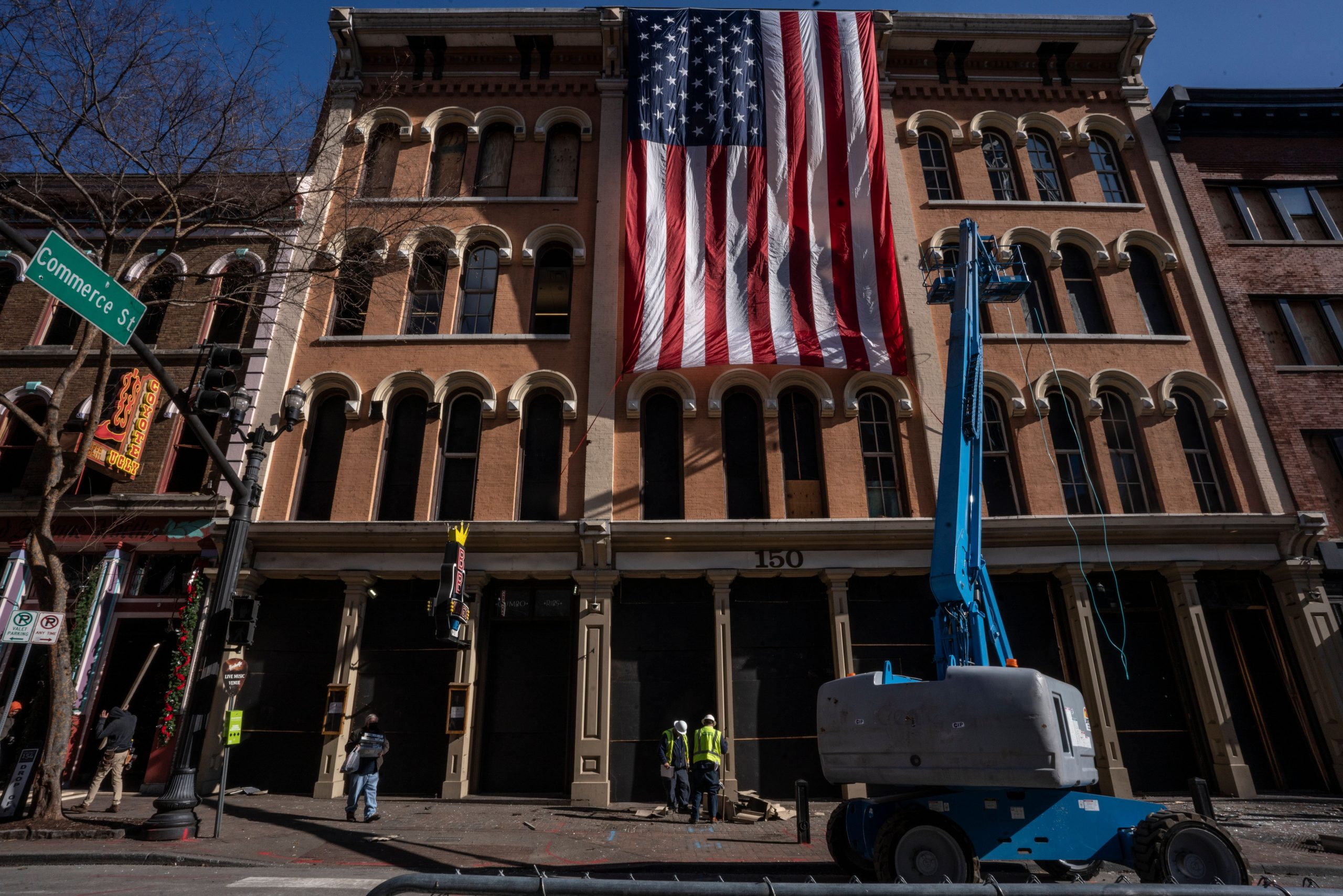 A huge American flag was draped from an undamaged building on Jan. 4, 2021. (Photo: John Partipilo)