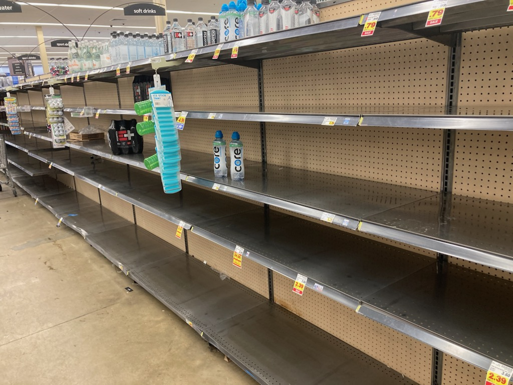 Store shelves are empty of milk and water at Kroger Trinity Commons in Cordova, Tennessee. Memphis Light Gas and Water has issued a first ever boil order alert due to low water pressure problems related to the recent winter storms that have passed through the area. (© Karen Pulfer Focht)