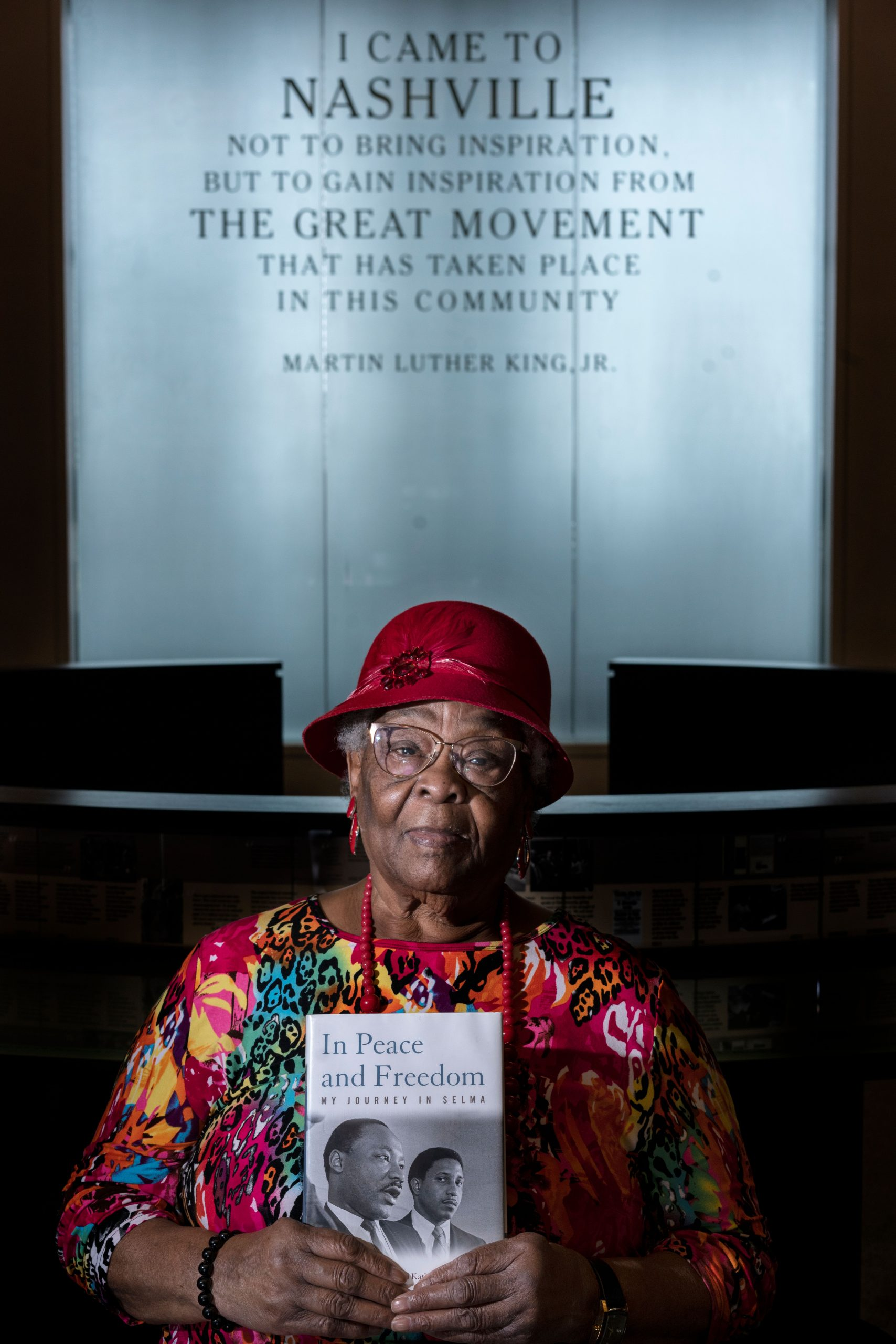 Etta Simpson Ray holds a copy of her friend and civil rights leader Bernard Layfayette's book. (Photo: John Partipilo)