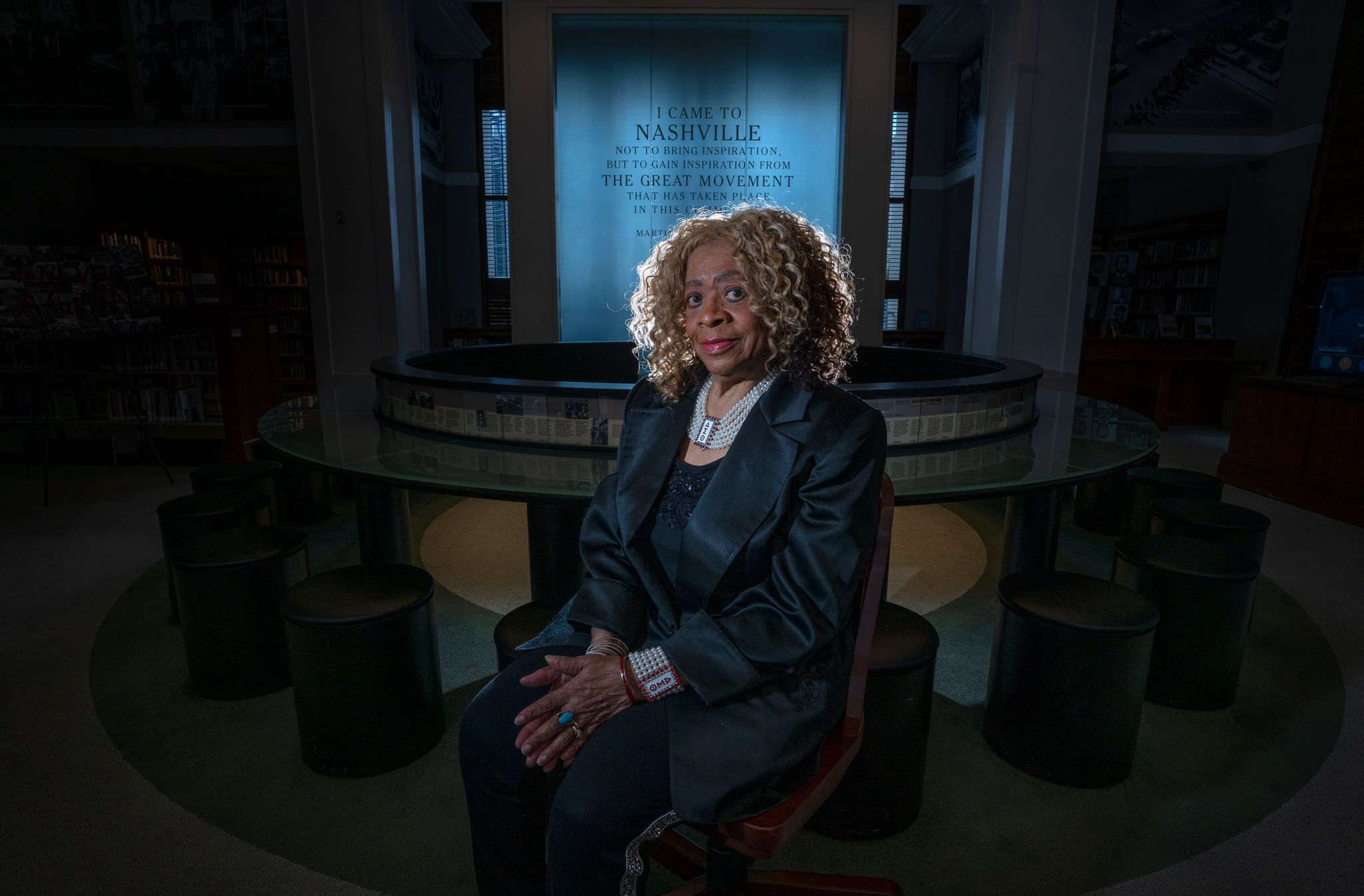 Frankie Henry sitting for photojournalist John Partipilo inside the Civil Rights Room of the Nashville Public Library.