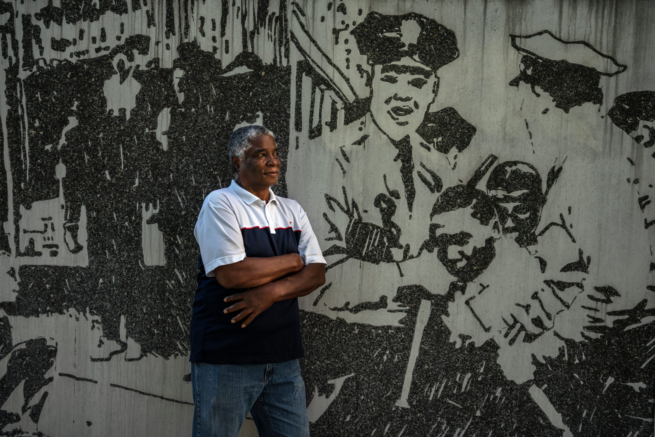 Frederick Leonard stands in front of the Civil Rights mural at the Historic Metro Courthouse. (Photo: John Partipilo)