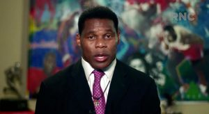 CHARLOTTE, NC - AUGUST 24: In this screenshot from the RNC's livestream of the 2020 Republican National Convention, former NFL athlete Herschel Walker addresses the virtual convention on August 24, 2020. The convention is being held virtually due to the coronavirus pandemic but will include speeches from various locations including Charlotte, North Carolina and Washington, DC. (Photo Courtesy of the Committee on Arrangements for the 2020 Republican National Committee via Getty Images)
