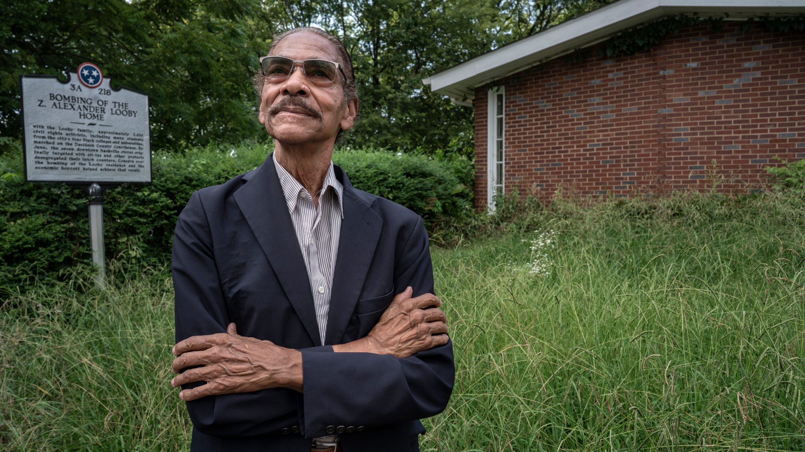 King Hollands poses outside the home owned by Nashville civil rights attorney Alexander Looby. Looby's home, near Fisk University and Meharry Medical College, was bombed in April 1960 by segregationists. (Photo: John Partipilo)