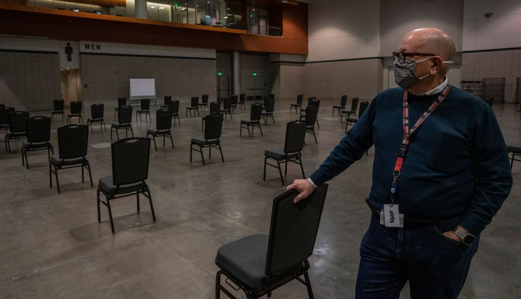 Dr. Gill Wright, interim chief medical director, Nashville Department of Health, stands in the Music City Center convention hall set for COVID-19 vaccine distribution (Photo: John Partipilo)