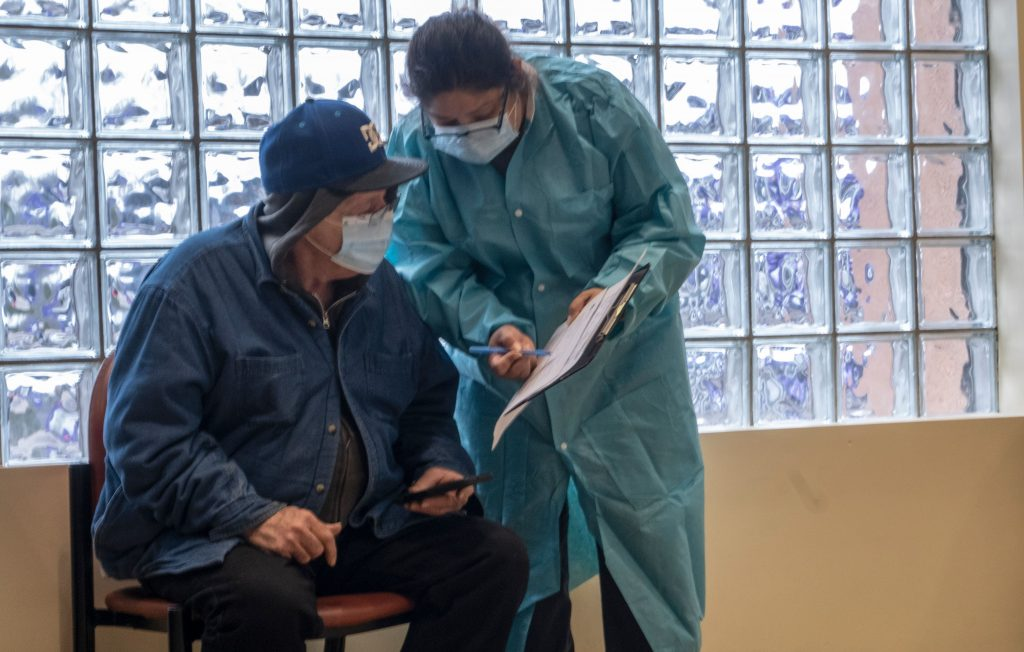 Arnoldo Garcia gets help from medical assistant, Jasmin Garcia at the Neighborhood Health clinic in Madison. (Photo: John Partipilo)