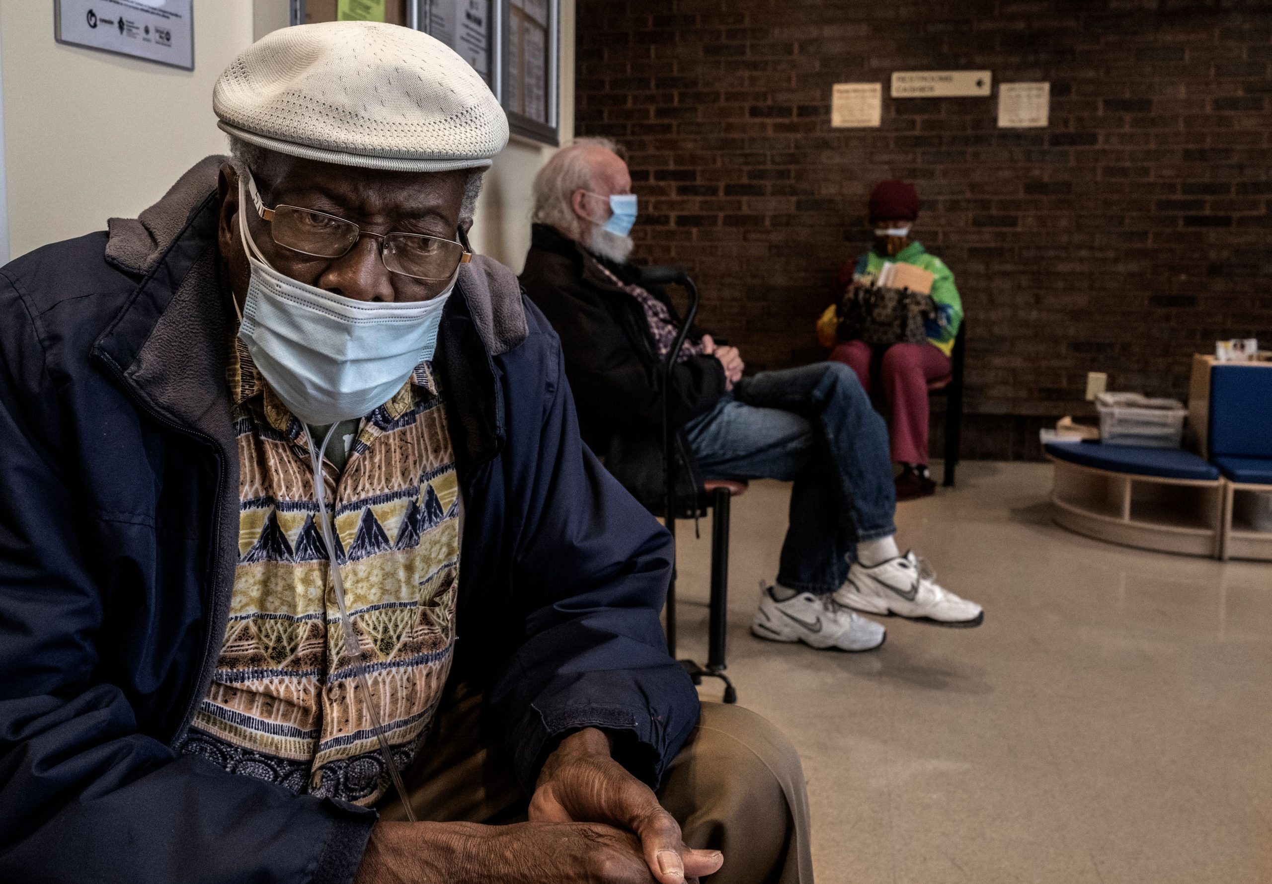 James Burroughs, 84, and other patients wait to get vaccinated at Neighborhood Health in Madison. (Photo: John Partipilo)