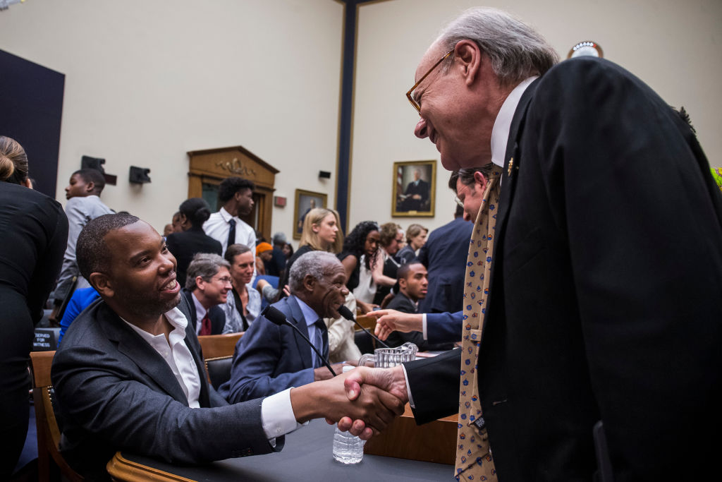 WASHINGTON, DC - JUNE 19: Writer Ta-Nehisi Coates shakes hands with House Subcommittee Chairman Steve Cohen (D-TN) during a hearing on slavery reparations held by the House Judiciary Subcommittee on the Constitution, Civil Rights and Civil Liberties on June 19, 2019 in Washington, DC. The subcommittee debated the H.R. 40 bill, which proposes a commission be formed to study and develop reparation proposals for African-Americans. (Photo by Zach Gibson/Getty Images)