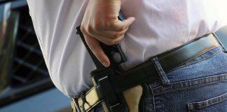 Tennessee Gov. Bill Lee is proposing a permit-less gun carry bill. The bill would allow people to carry a handgun without a permit as long as they are legally allowed by state law. At the same time the governor's bill has created a new set of penalties for those who use weapons to commit crimes. (Photo taken Feb. 3, 2021 in Memphis, Tennessee by Karen Pulfer Focht)