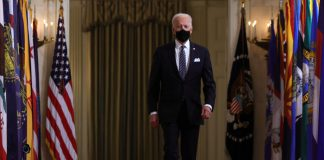WASHINGTON, DC - MARCH 11: U.S. President Joe Biden arrives to give a primetime address to the nation from the East Room of the White House March 11, 2021 in Washington, DC. President Biden gave the address to mark the one-year anniversary of the shutdown due to the COVID-19 pandemic. (Photo by Alex Wong/Getty Images)