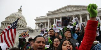 Protesters in front of the Senate side of the U.S. Capitol urge Congress to pass the Deferred Action for Childhood Arrivals program in December 2017. (Mark Wilson/Getty Images)