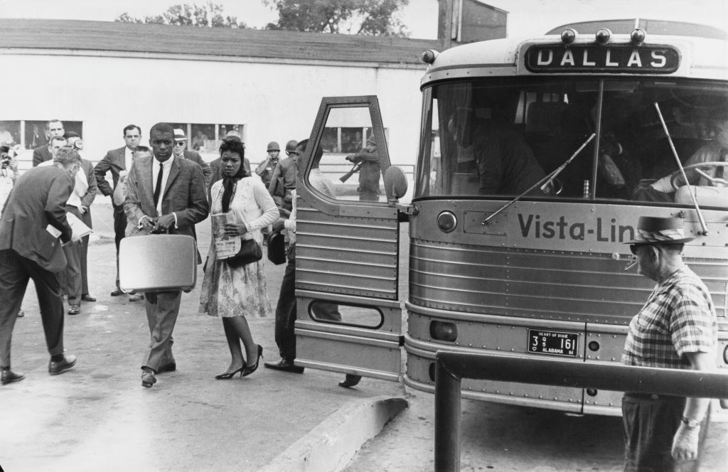 Civil rights activists known as the Freedom Riders disembark from their bus (marked Dallas), en route from Montgomery, Alabama, to Jackson, Mississippi, as they seek to enforce integration by using 'white only' waiting rooms at bus stations, 26th May 1961. (Photo by Daily Express/Archive Photos/Hulton Archive/Getty Images)