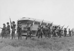 The military guard a bus en route from Montgomery, Alabama, as civil rights activists known as the Freedom Riders head for Jackson, Mississippi, 26th May 1961. (Photo by Express/Archive Photos/Getty Images)