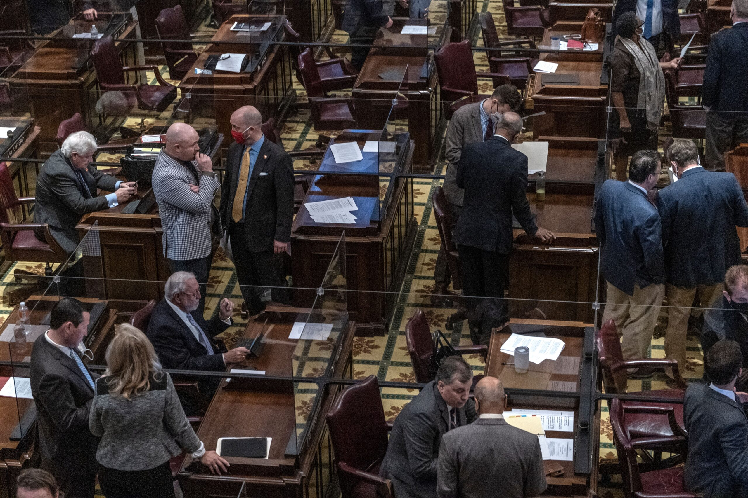 Members of the Tennessee House of Representatives mill about in House Chambers. (Photo: John Partipilo)