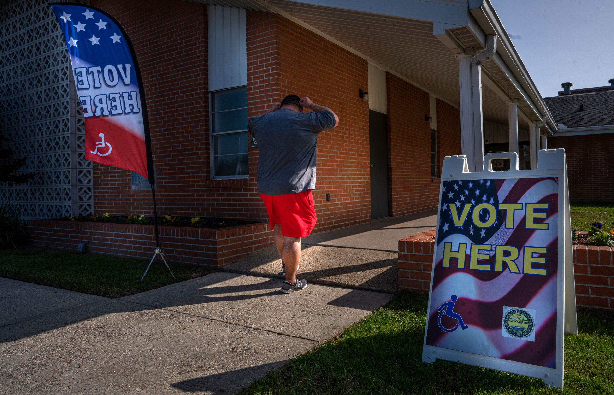 A voter enters Trinity Baptist Church in Manchester to vote.