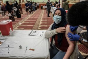 Lines of people wait to be vaccinated on March 11 as Drod Kokoyo gets preped for her first shot. (Photo: John Partipilo)
