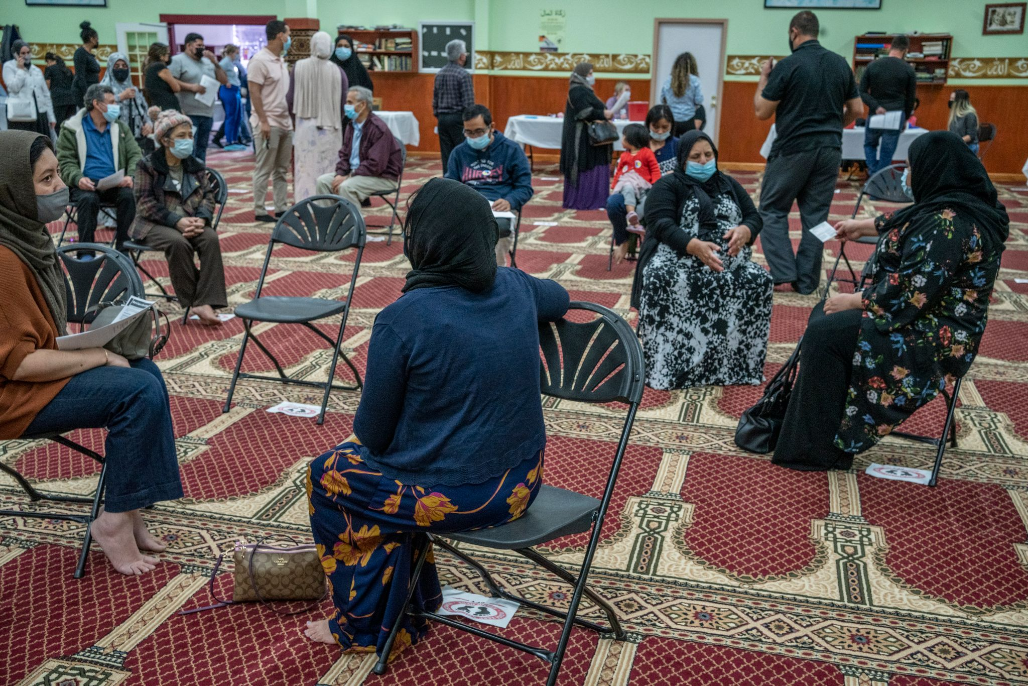 After getting vaccinated, people wait 15 minutes after being vaccinated. About 190 people received vaccinations March 11 at the Salahadden Center and Mosque. (Photo: John Partipilo)