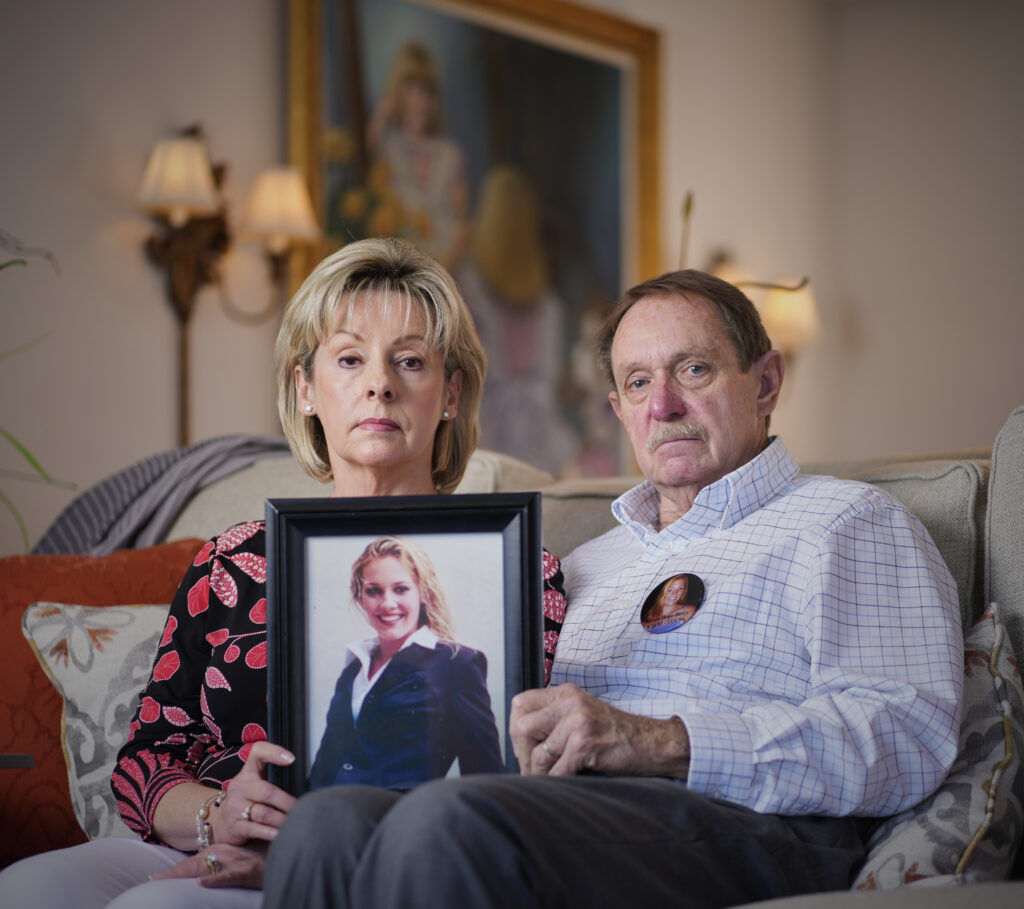Joan and Mike Berry hold a framed photograph of their daughter, Johnia. (Photo: Patrick Murphy-Racey)