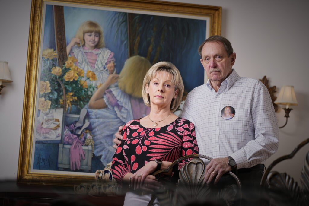 Joan and Michael Berry, Johnia Berry's parents, in their Knoxville home. A portrait of Johnnia as a little girl hangs in the background. (Photo: Patrick Murphy-Racey)