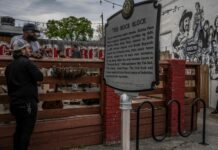 """A historical marker for the Elliston Place """"Rock Block"""" is positioned just outside the Exit/In. (Photo: John Partipilo)"""