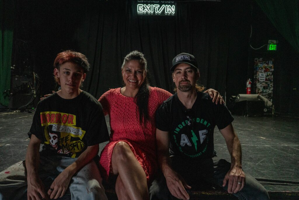 Exit/In owners Telisha and Chris Cobb with their son, Spike, sit on stage at the Exit/In. (Photo: John Partipilo)