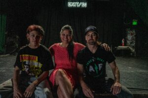 Exit / In owners Telisha and Chris Cobb with their son Spike sit on stage at Exit / In.  (Photo: John Partipilo)