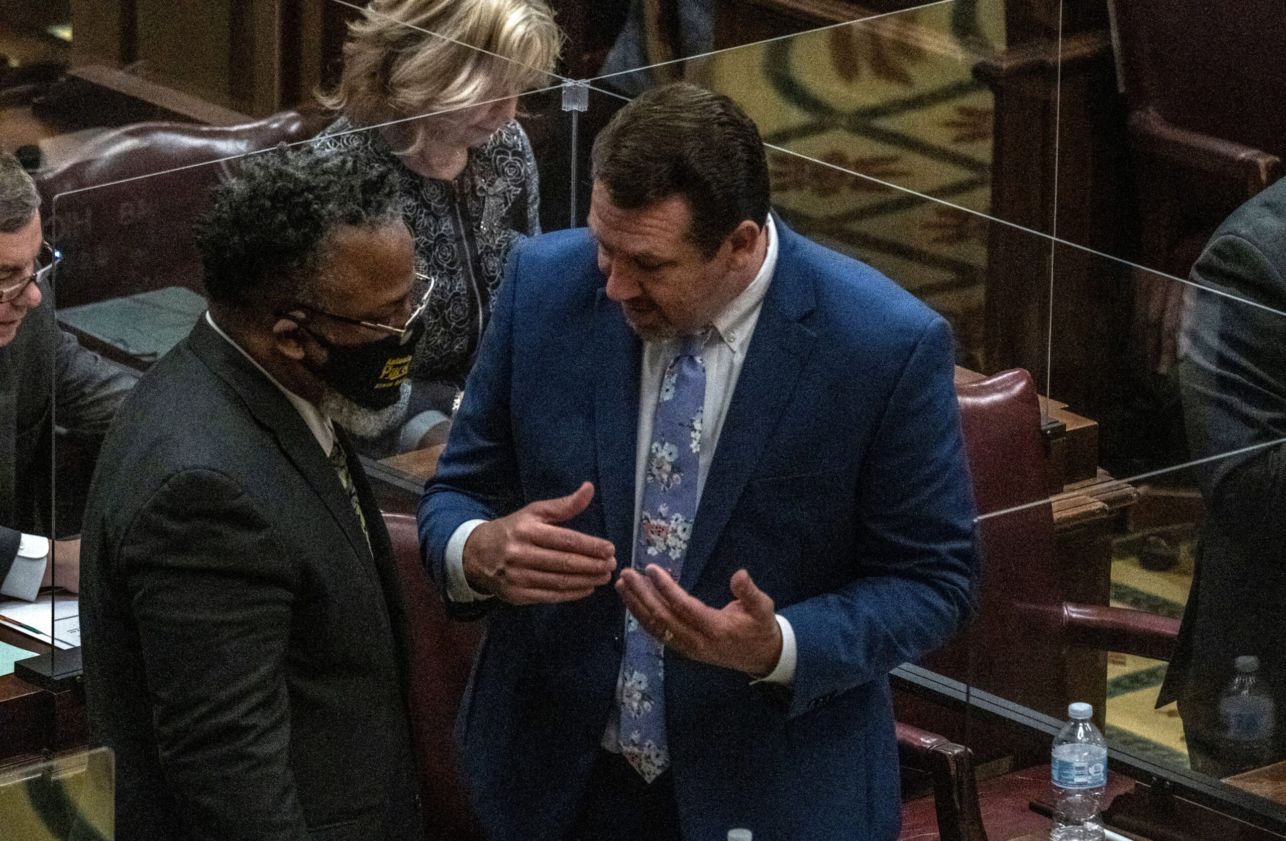 Republican House Caucus Chair Jeremy Faison, at right, talks with Memphis Democrat Antonio Parkinson recently in House chambers. (Photo: John Partipilo)